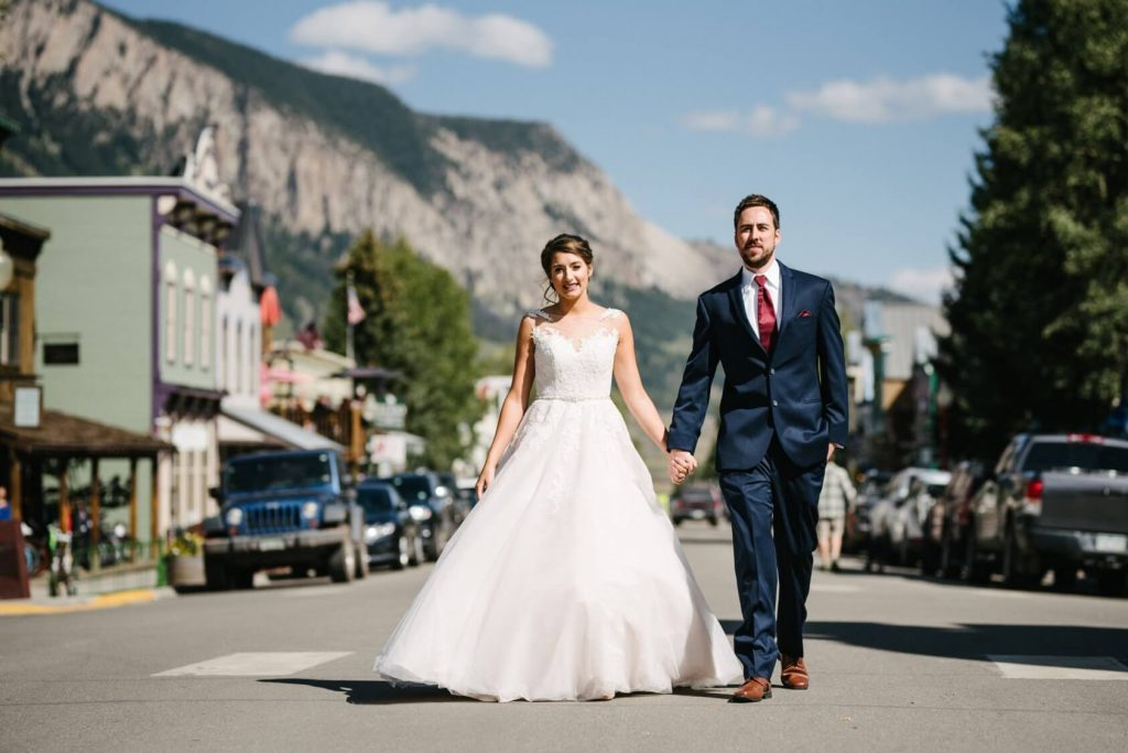 bride and groom walking in the town of Crested Butte, Colorado on their wedding day