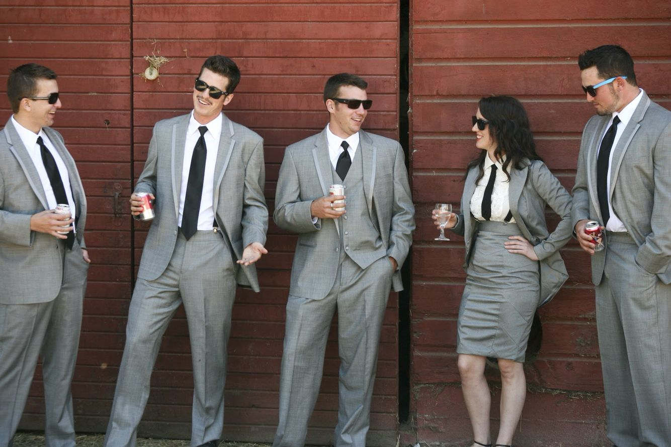 four guys in grey suits and one lady in grey skirt and jacket