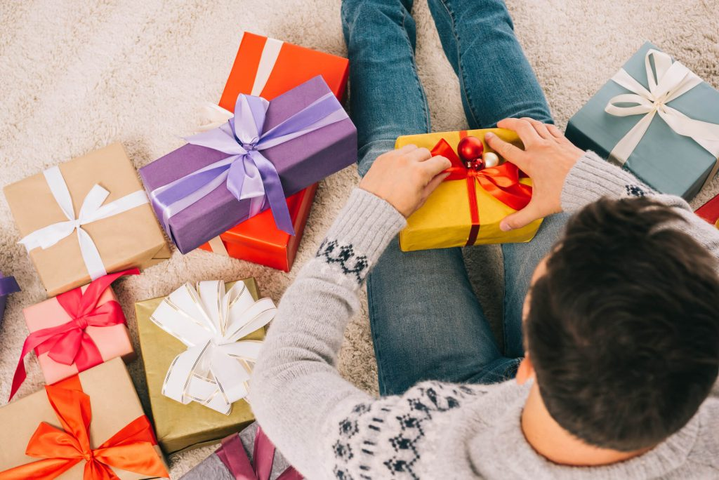man opening gifts