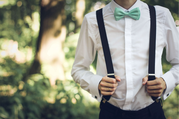 Guy wearing suspenders with mint green bow tie
