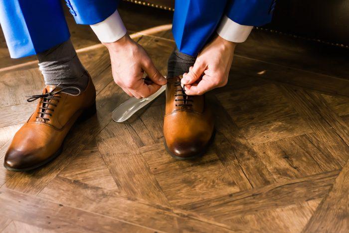 Man tying dress shoes