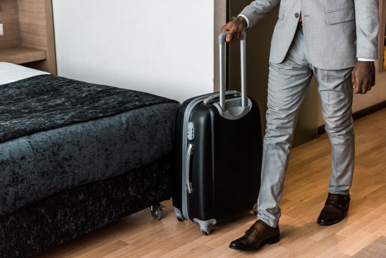 Man in a suit with a suitcase