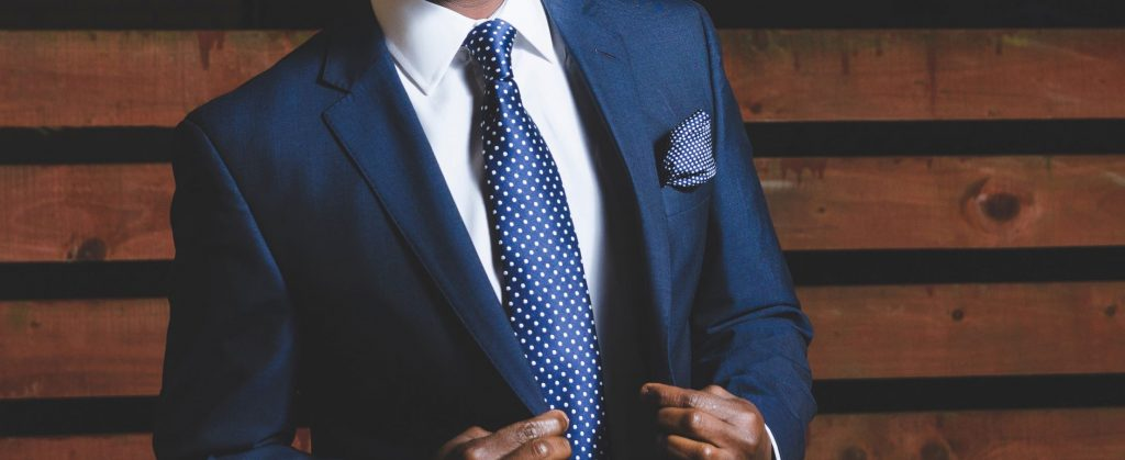 How to Choose the Right Tie - Man in a blue suit with a tie
