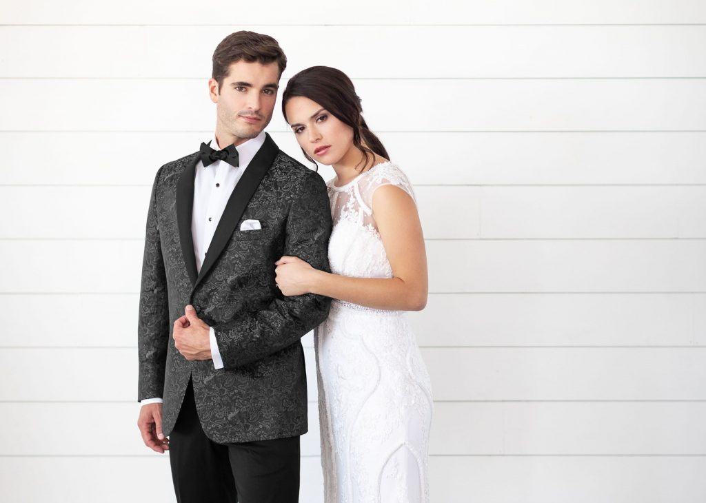 Picking a Tux: Groom in a stylish wedding tux with his bride