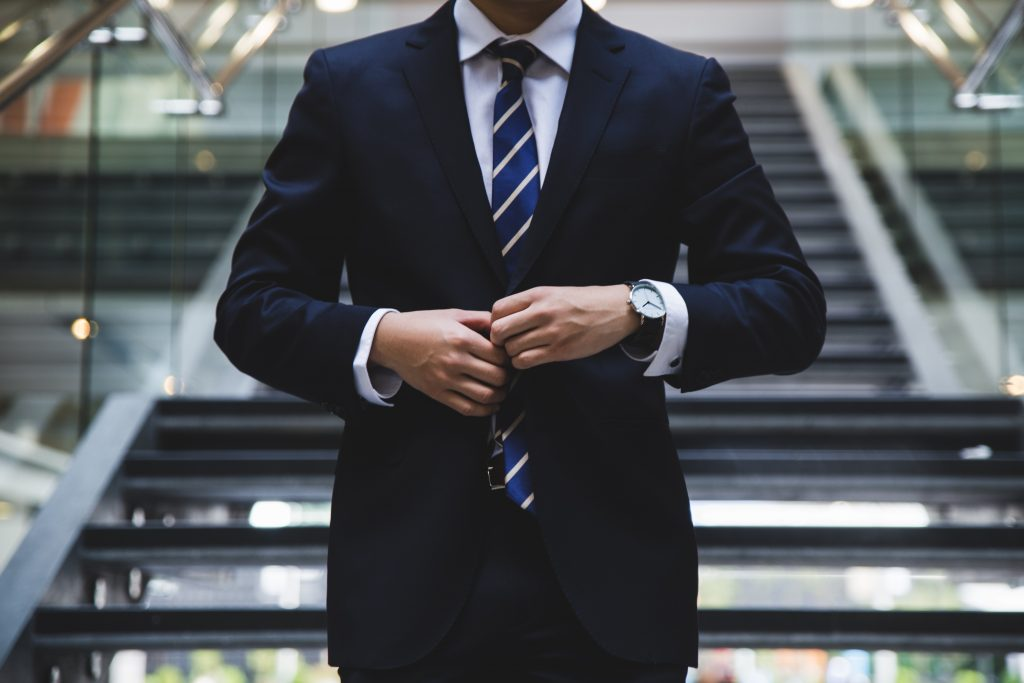Buying your first suit - Man in a navy suit - Jim's Formal Wear