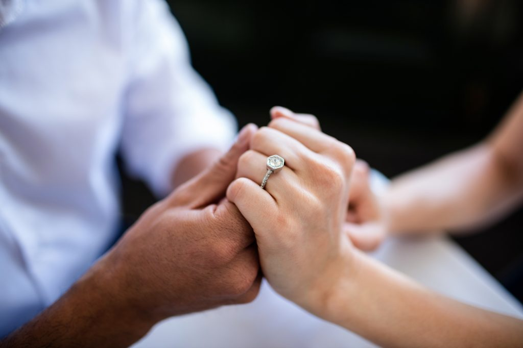 How to Pick out an Engagement Ring - Couple holding hands