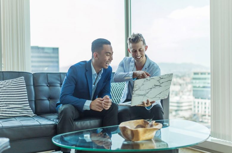 when to wear a suit to an interview - two business men reviewing a document