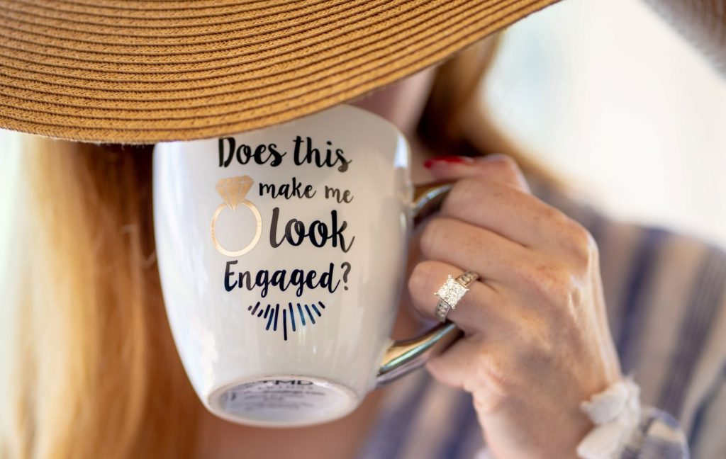 How to Pick Out an Engagement Ring - Woman with a ring and a coffee cup