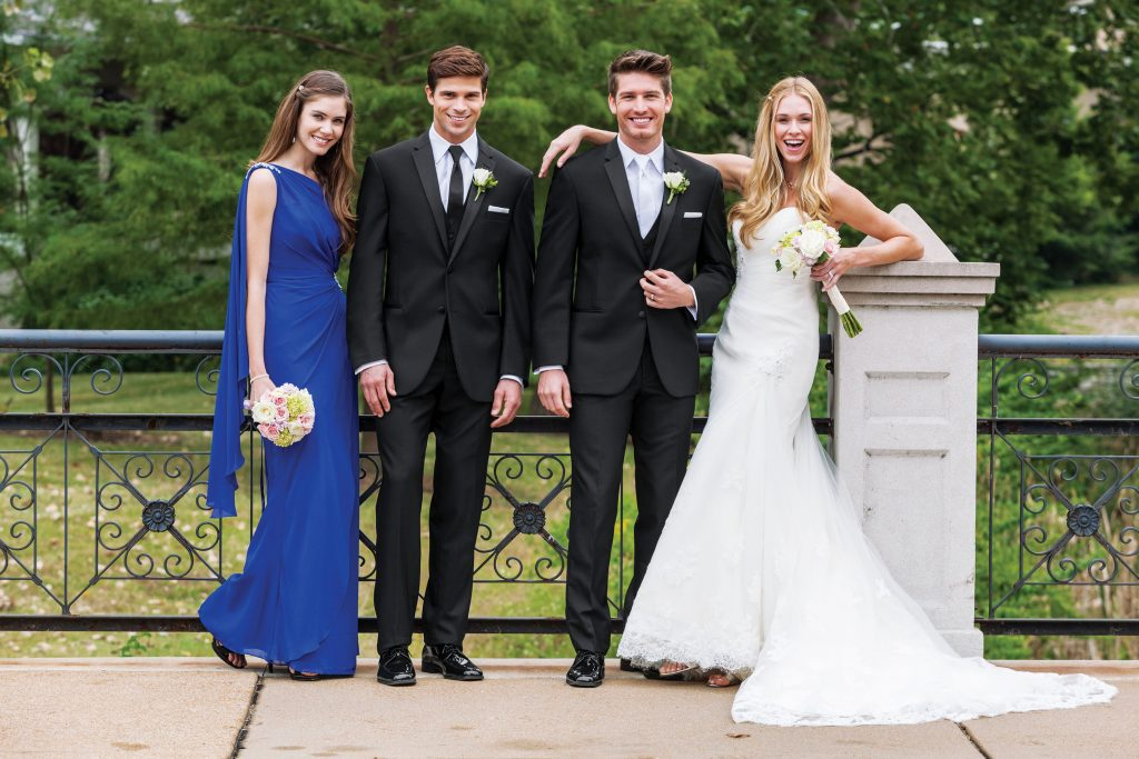 Bridesmaid, Groomsman, Groom, and Bridge smiling f or a photo - Your Guide to a Custom Tuxedo