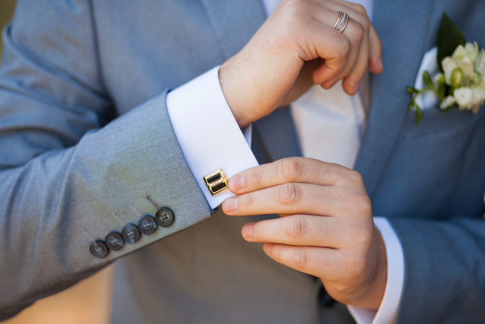 How to Pick the right cufflinks - Man in gray tuxedo adjusting cufflink