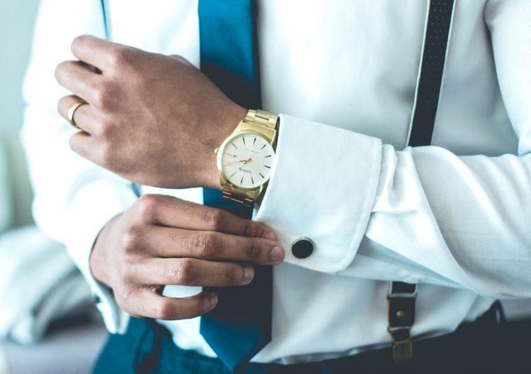 How to pick the right cufflinks - Man fastening cufflinks on shirt