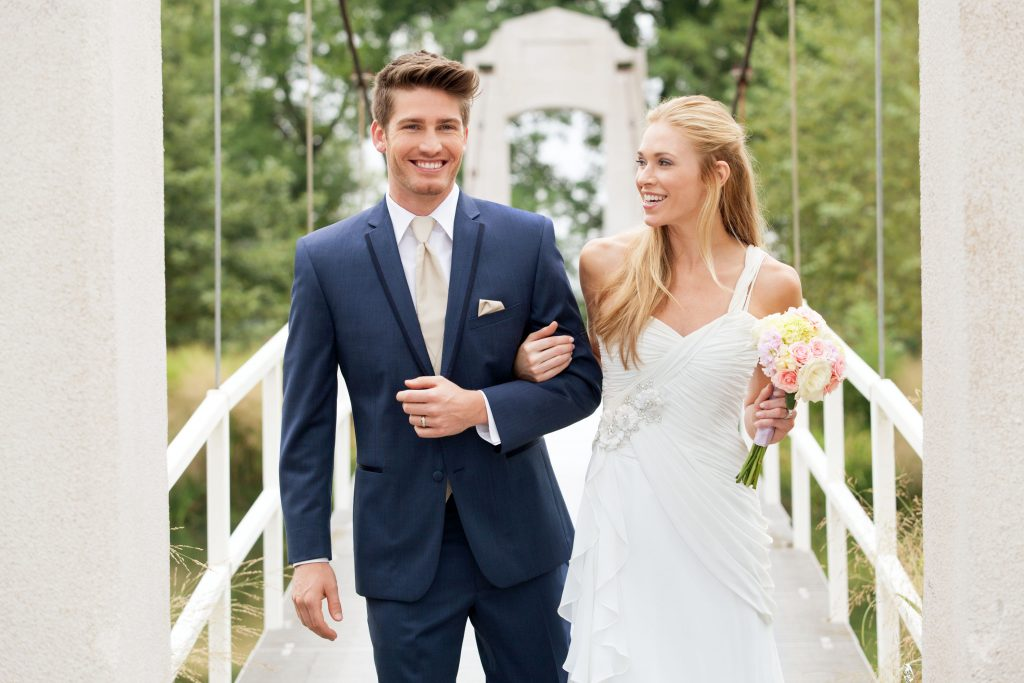 How to clean a suit at home without dry cleaning - A man in a blue suit with the bride