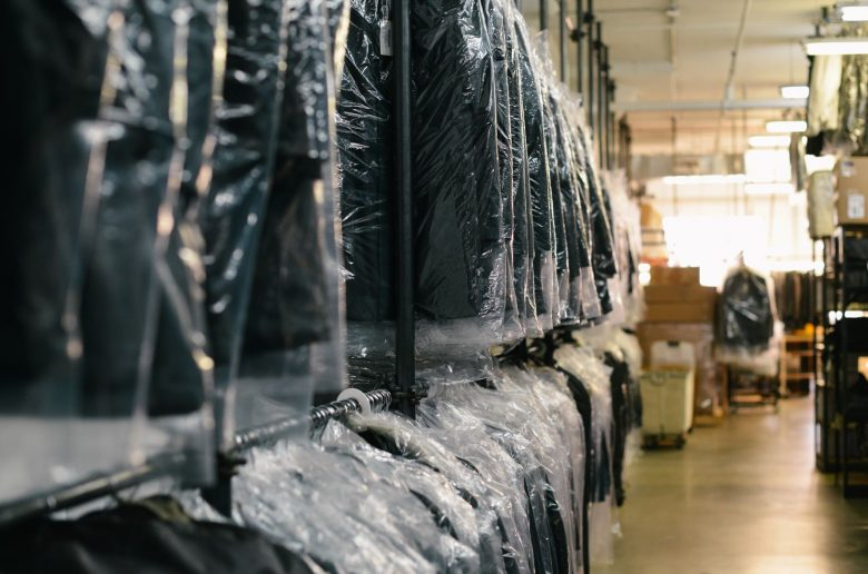 How to clean a suit without dry cleaning - Suits in bags on a rack