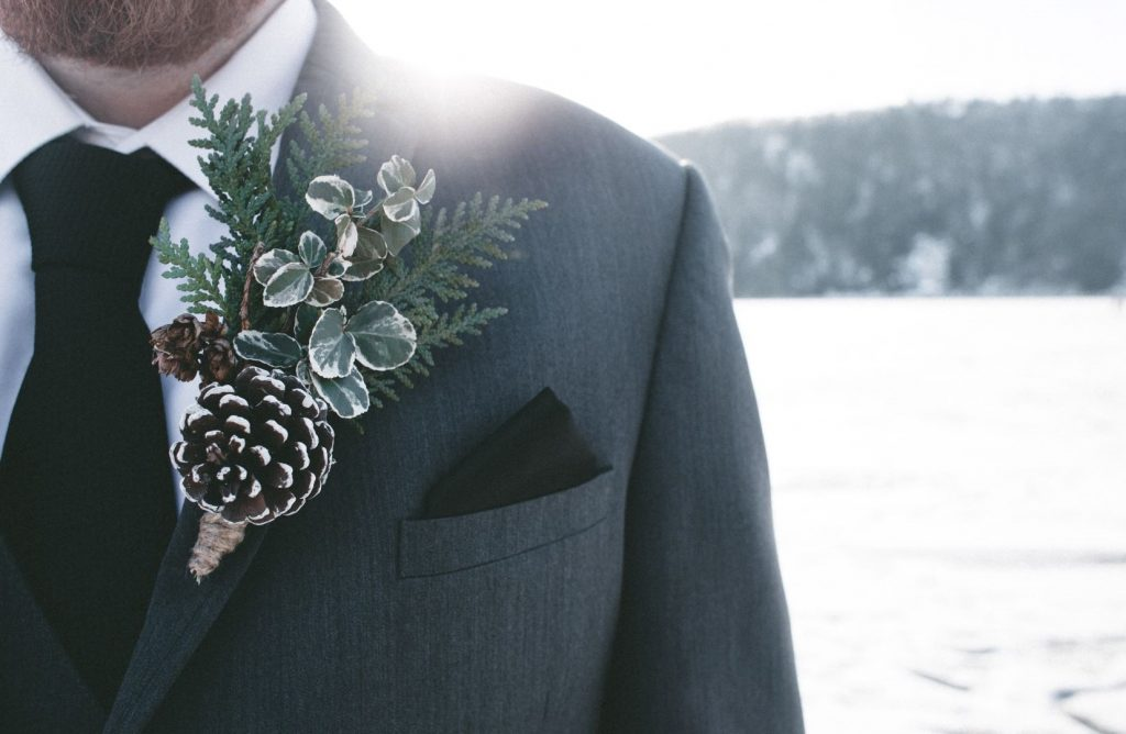 How to wear a Boutonniere - Man with a winter themed Boutonniere