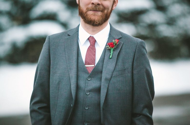 Winter Boutonnieres - Man with a simple red rose boutonniere