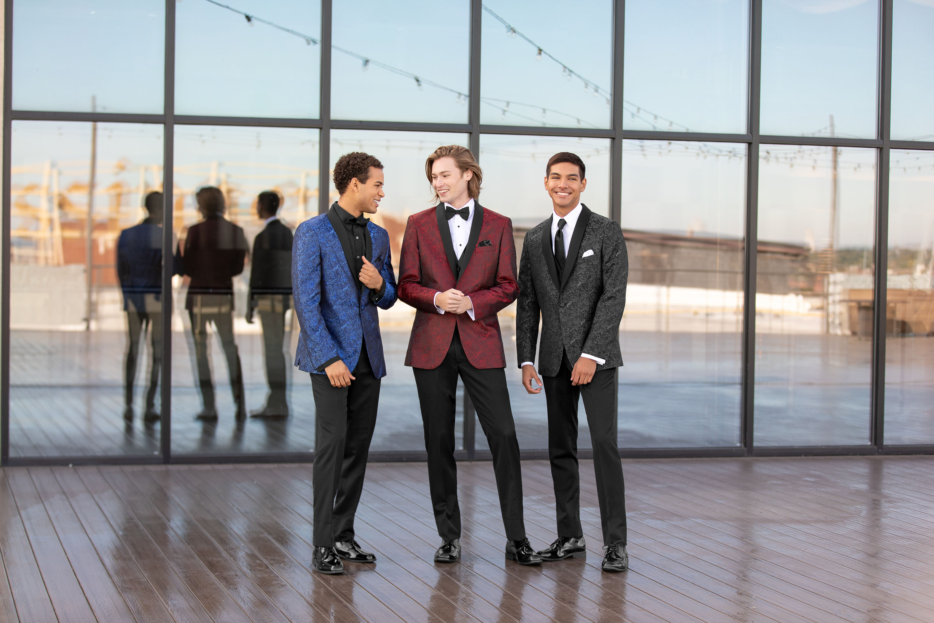 New Tux Trends to Try - Three young men standing together in unique patterned and color tuxes
