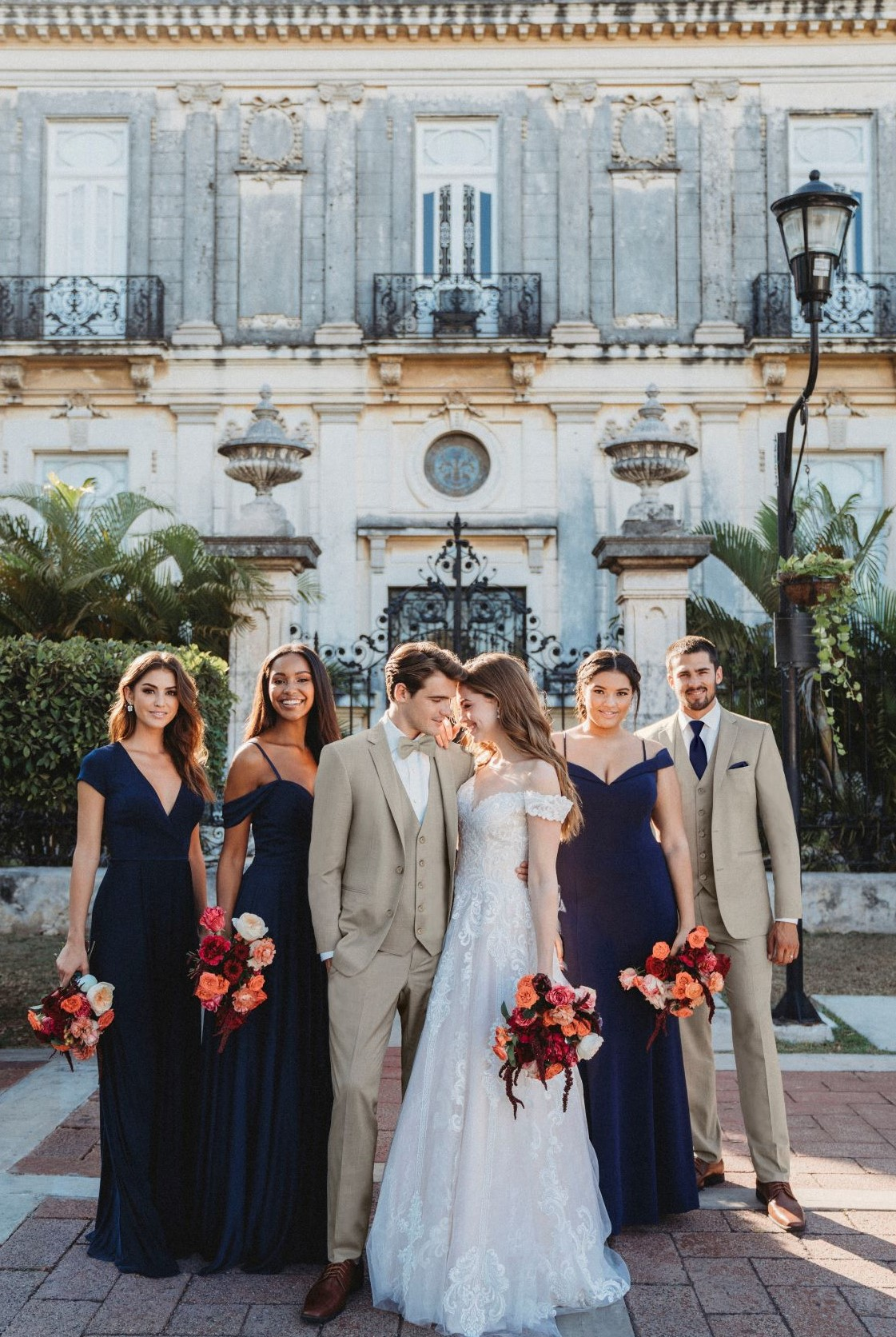 What to wear to a spring wedding - Men in tan suits with bridesmaids and bride