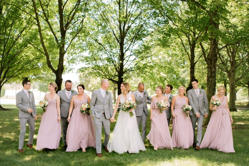 Spring wedding: what to wear - Groomsmen in heather gray suits next to bridesmaids in pink