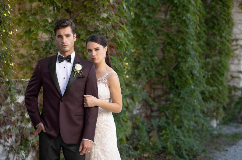 Non-traditional wedding looks - Groom and bride, groom wearing a burgundy tuxedo