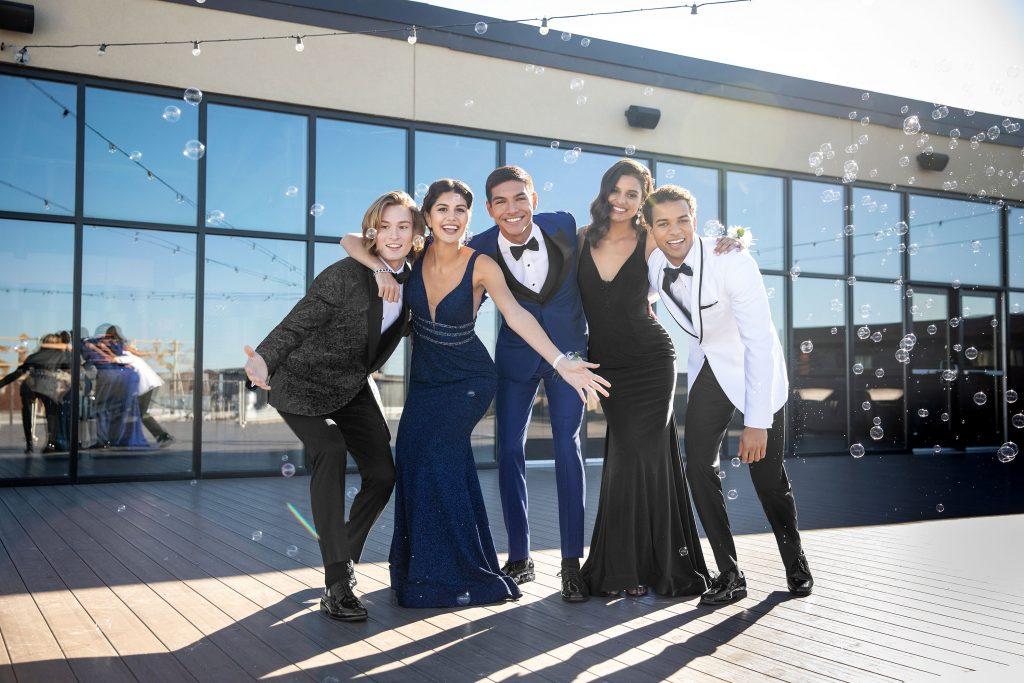 How to match a tux to a prom dress - group of students at prom