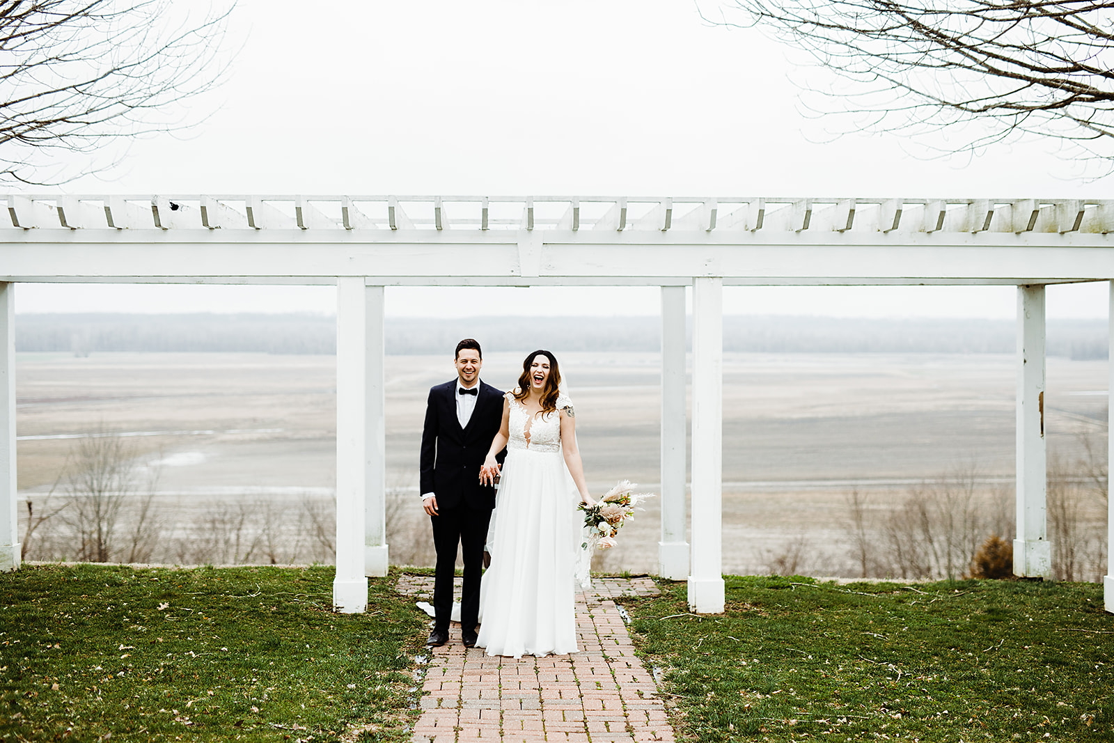 minimony or microwedding - bride and groom under a trellis
