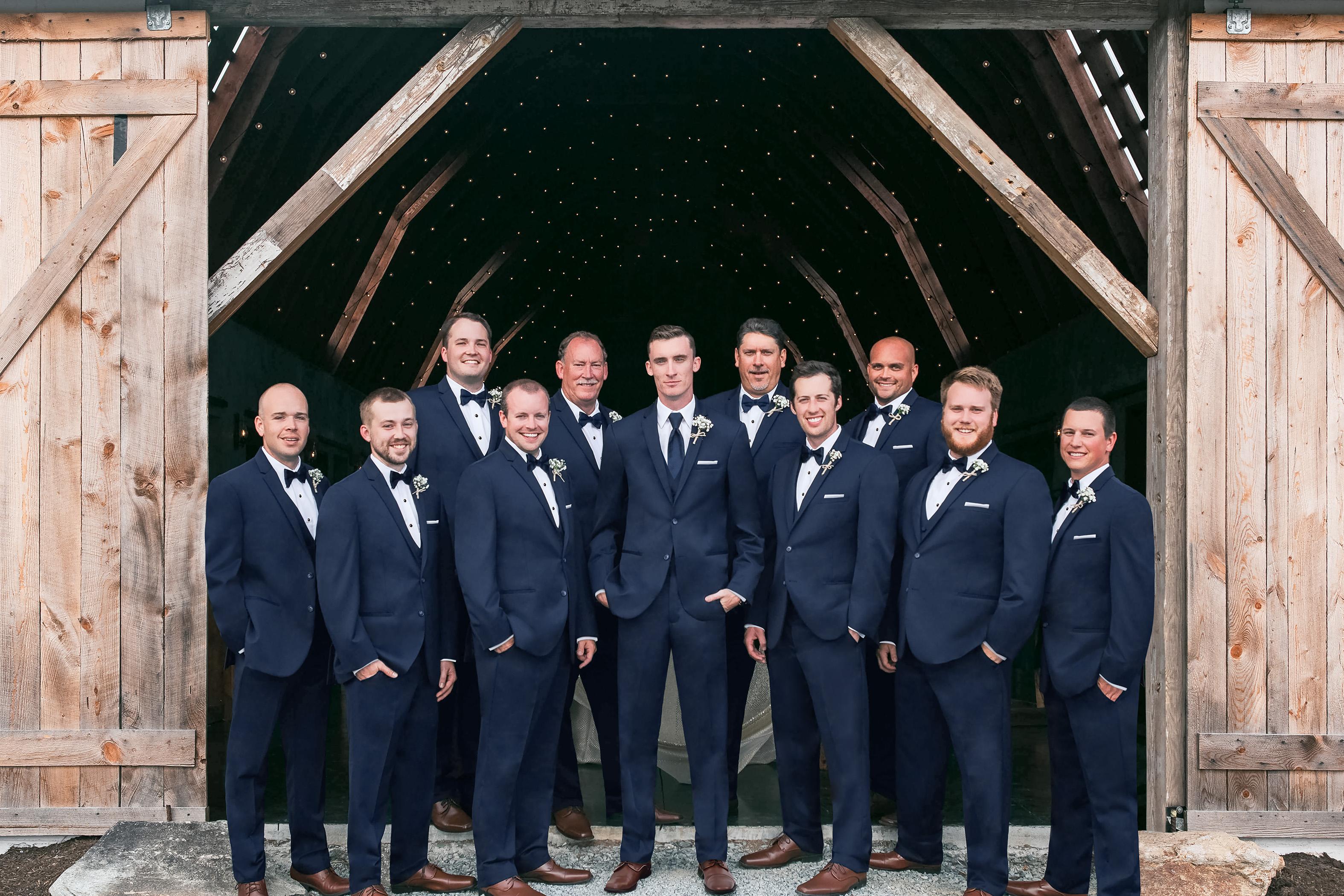 how to order groomsmen tuxedos - groomsmen posing in blue suits