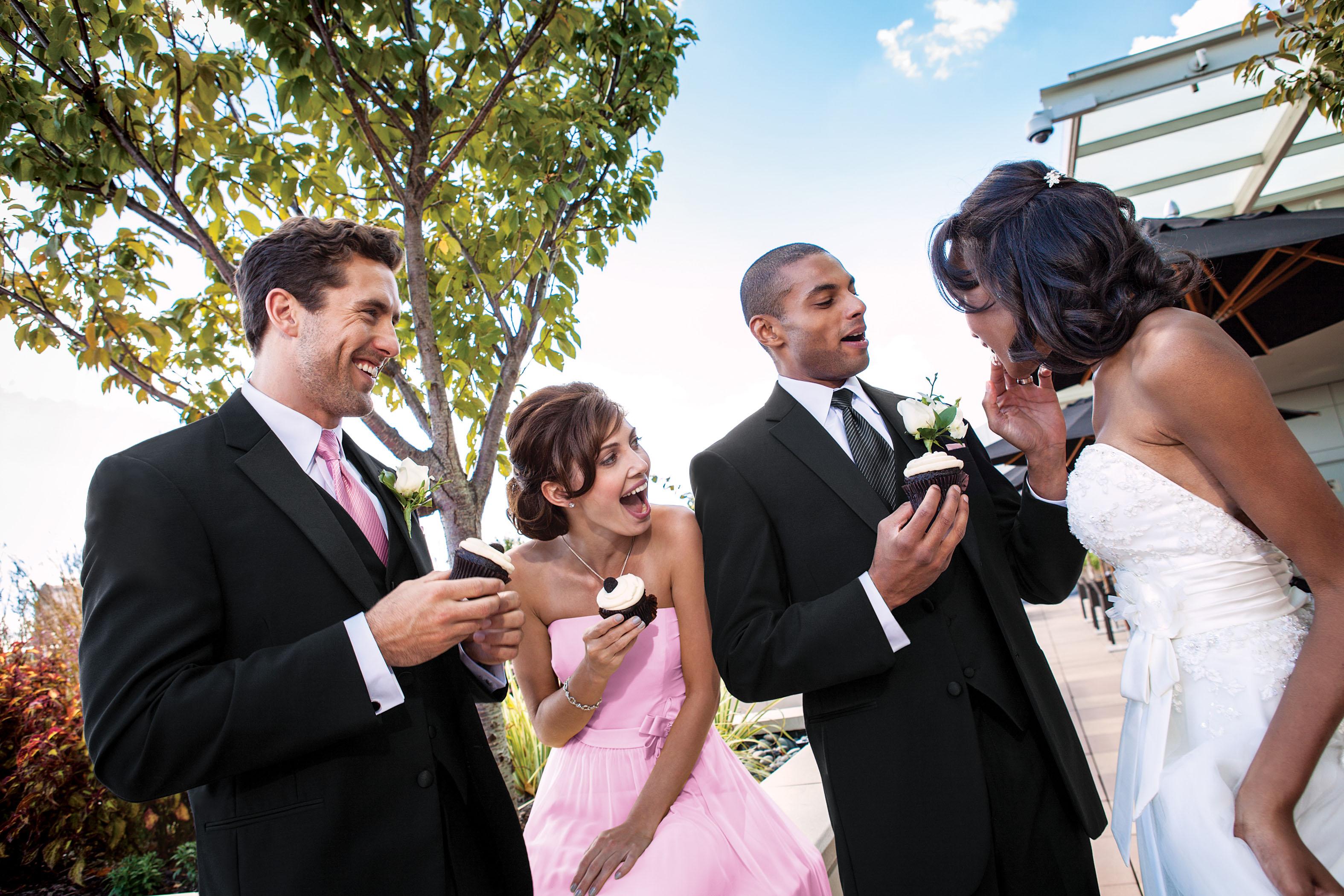 wedding party enjoying cupcakes on wedding day
