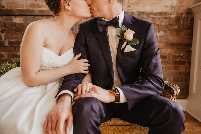 Best Wedding Dates - Bride and Groom Kissing