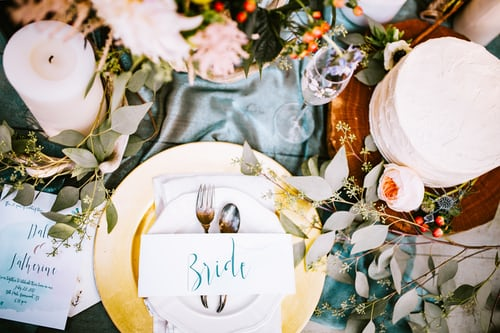 wedding table with flowers, plates, glasses