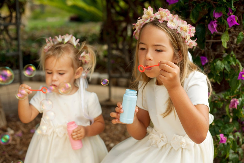 flower girls blowing bubbles
