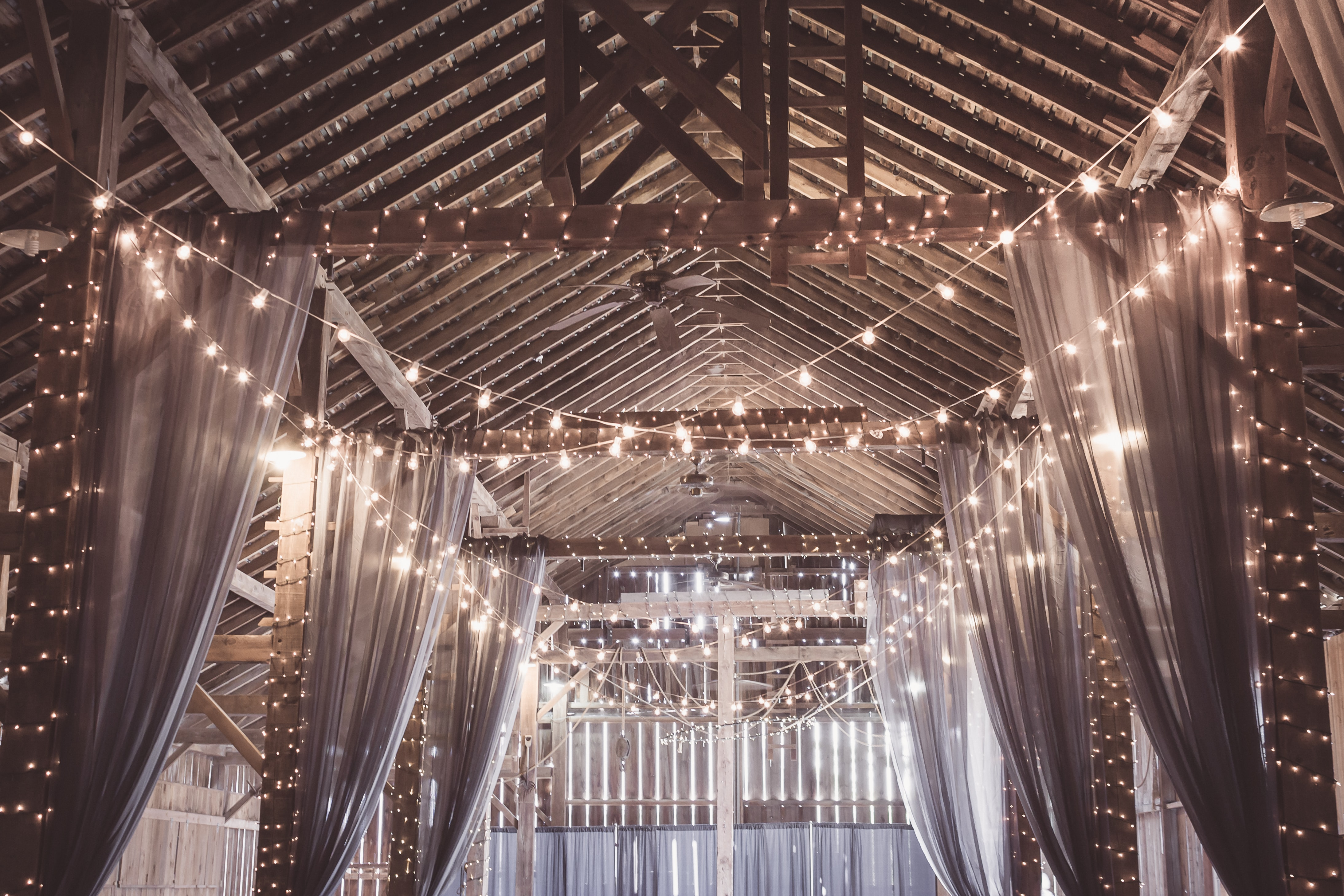 trends for weddings in 2021 - a bunch of string lights inside a venue