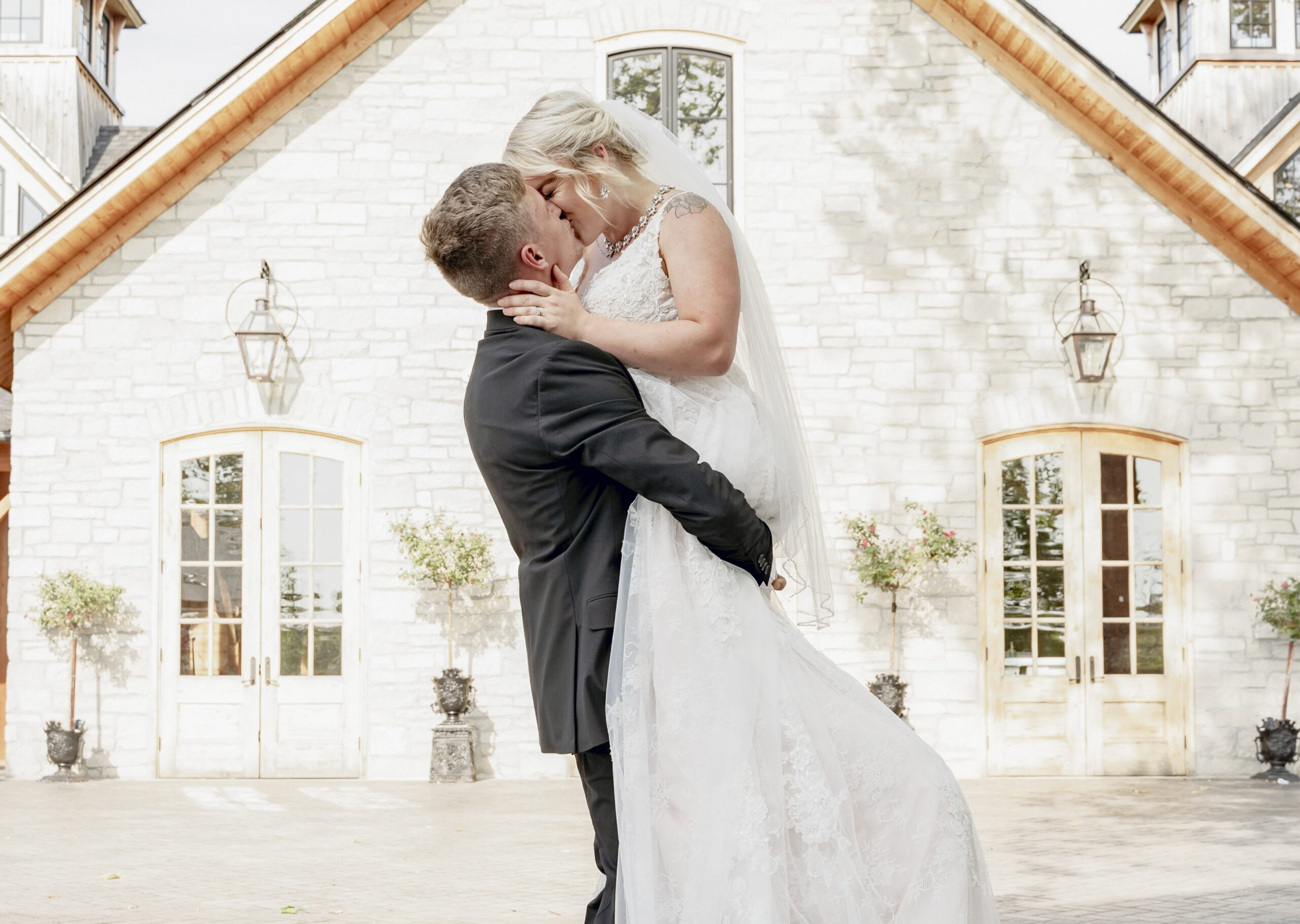 wedding insurance - bride and groom kiss in front of church