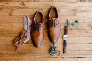 eco-friendly wedding, men's accessories on wood floor