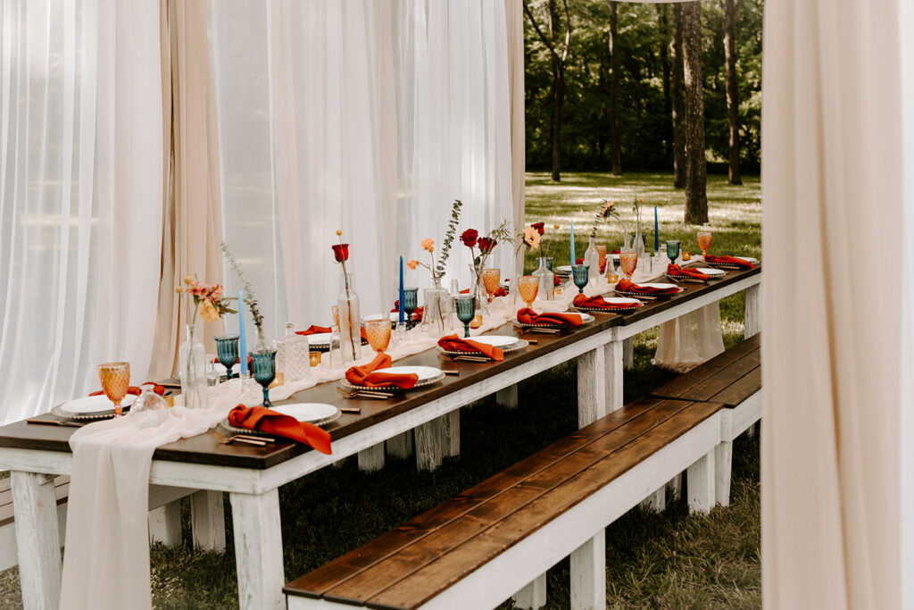 tasks to delegate - wedding table decorated with flowers and candles