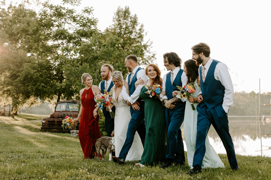 tasks to delegate - wedding party walking arm in arm