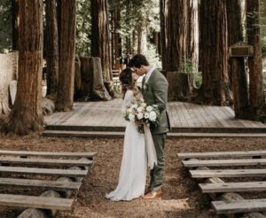 eco-friendly wedding, bride groom kissing in forest