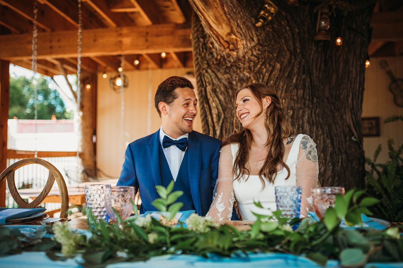 eco-friendly wedding, bride groom at table laughing