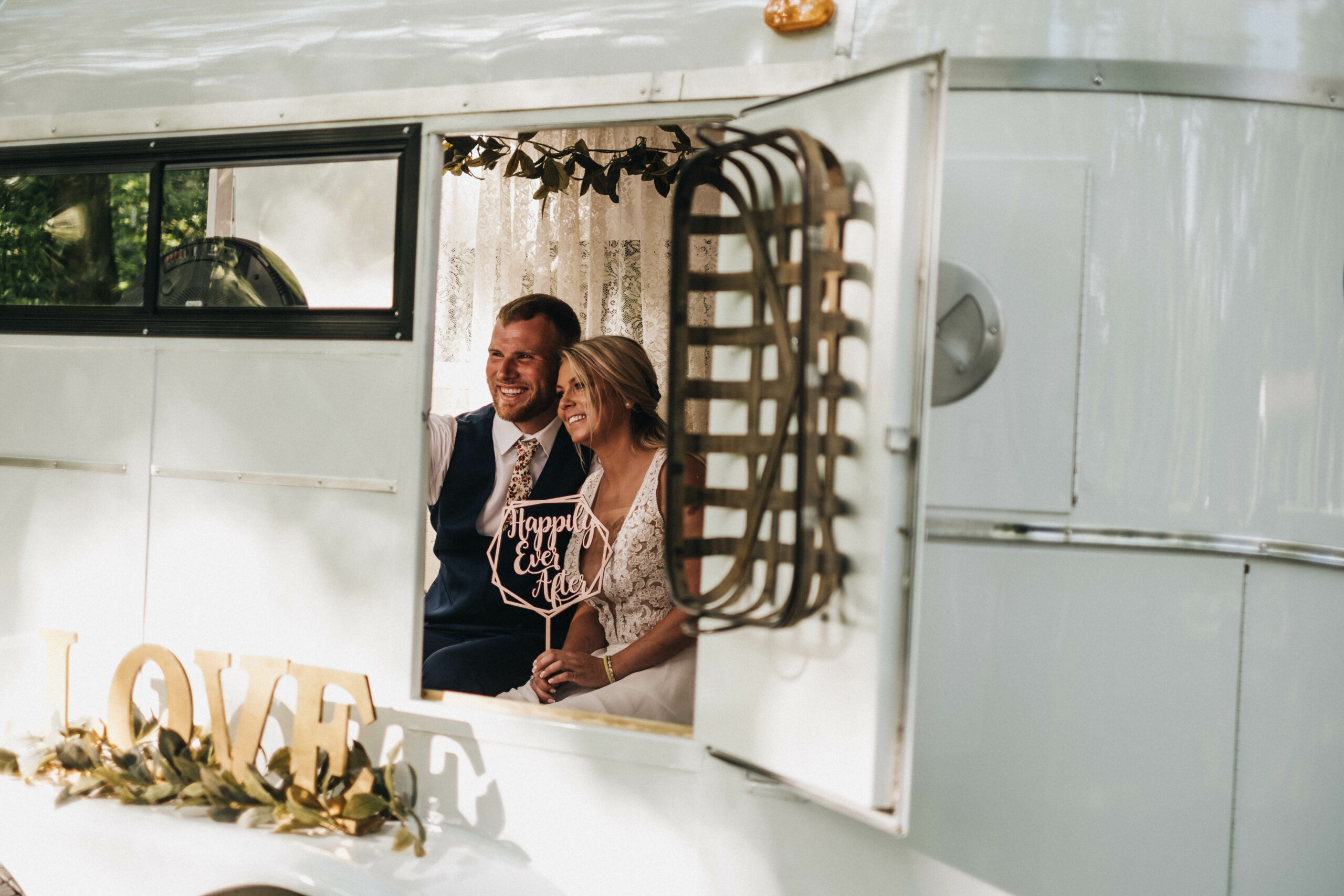 when should I order my tuxedo rental - bride and groom in photo booth