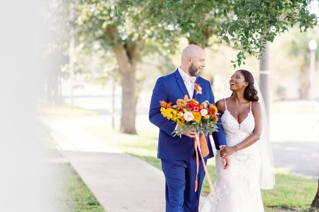when should I rent a tuxedo - bride and groom walking on path