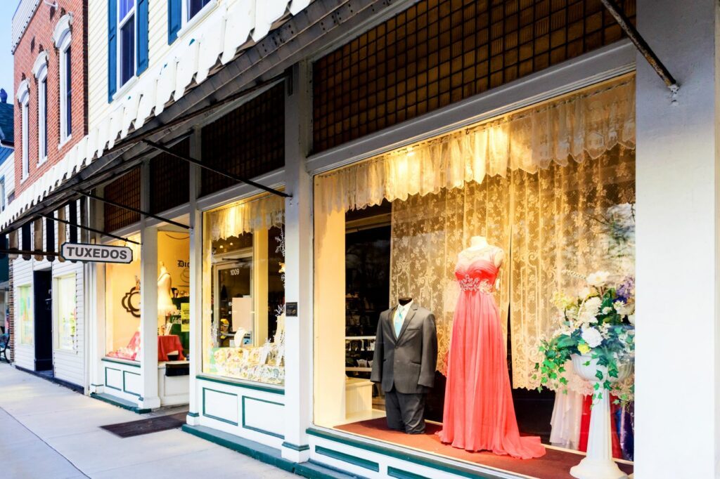 support small businesses - tuxedo rental shop store front