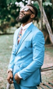 black nam in cornflower blue suit and bold patterned tie