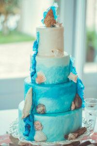 beach wedding cake with seashells