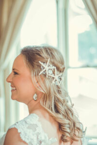 bride with hair half pulled back with star fish accents