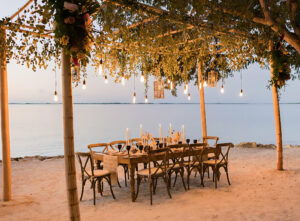 table on beach with lighting above table