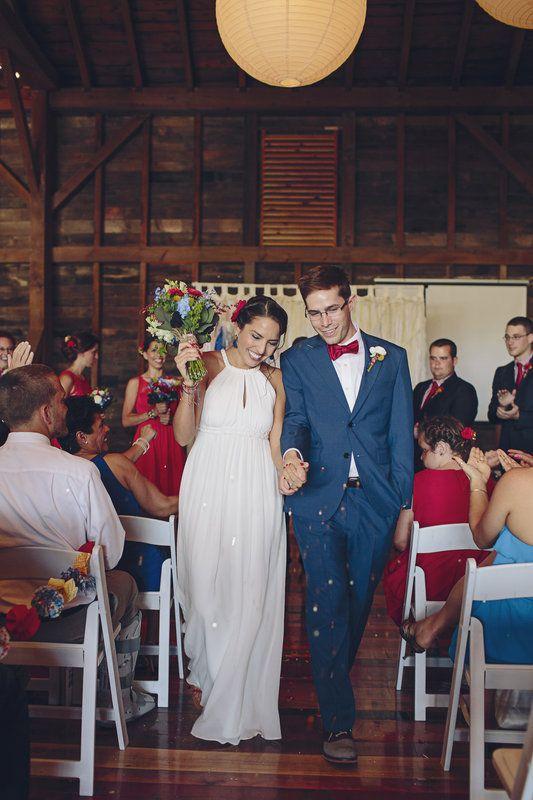 Bride and groom walking down aisle. Festive Americana Wedding Must Haves
