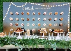 wall of donuts and cake plate with donuts stacked