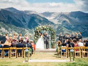 Outdoor wedding ceremony overlooking the mountains. Festive Americana Wedding Must Haves.