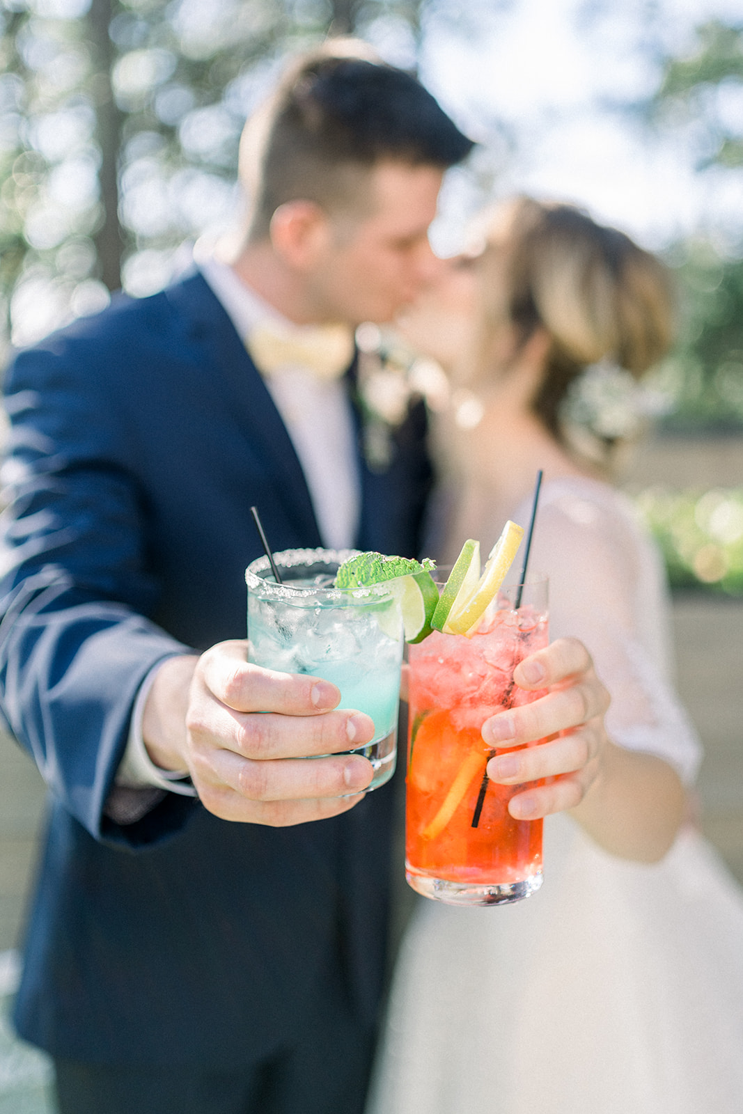 bride and groom holding signature cocktails
