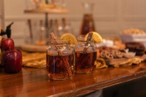 warm cider drink with cinnamon stick