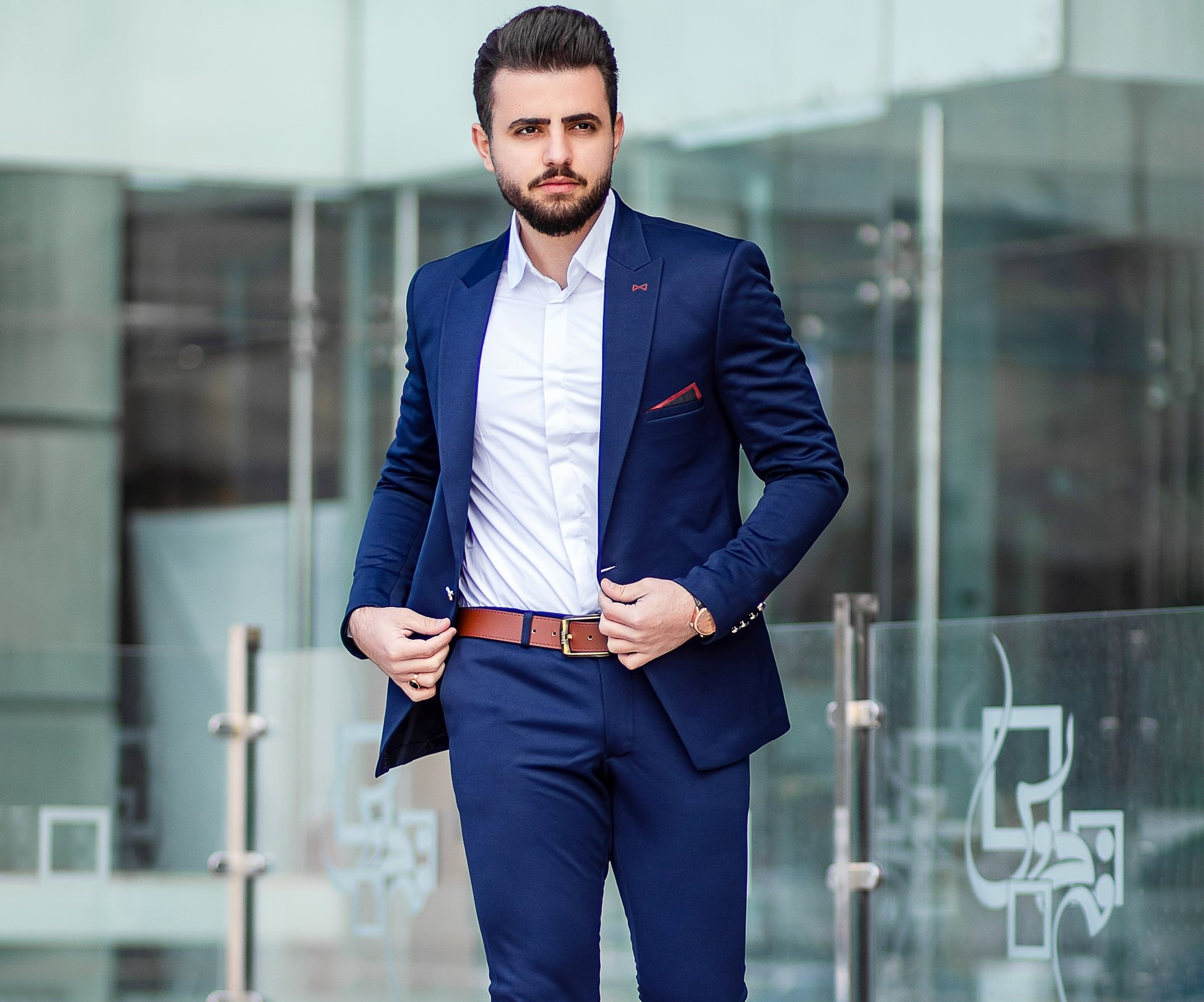 man in blue suit without a tie and brown belt